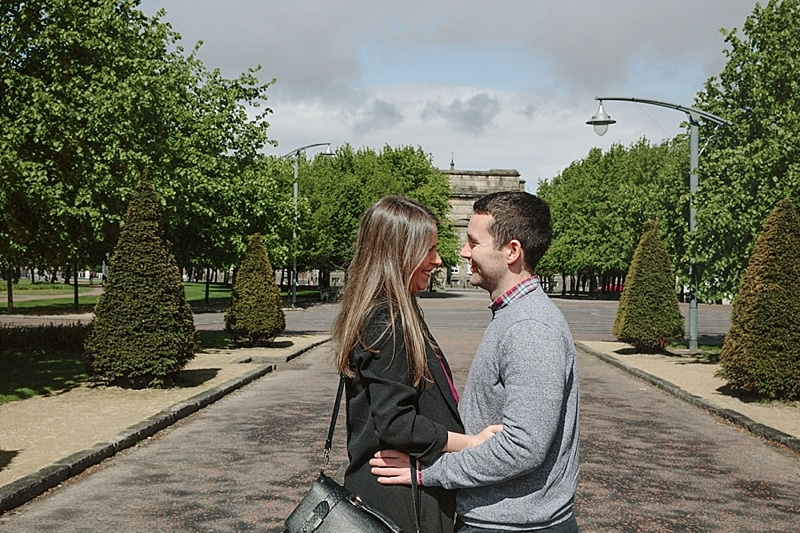 relaxed couple standing in glasgow for their engagement shoot