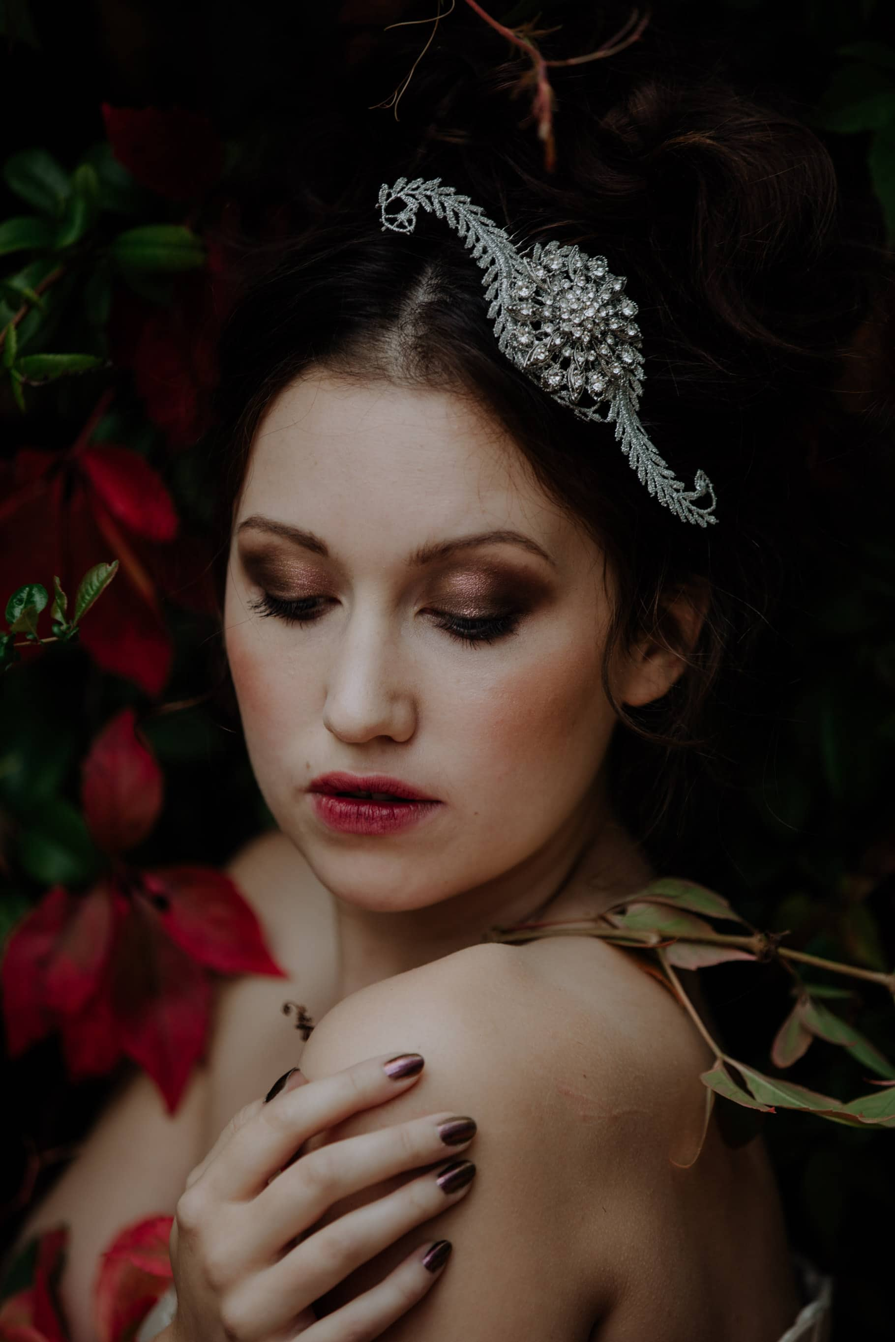 lucy scarfe model looking down with moody wedding makeup