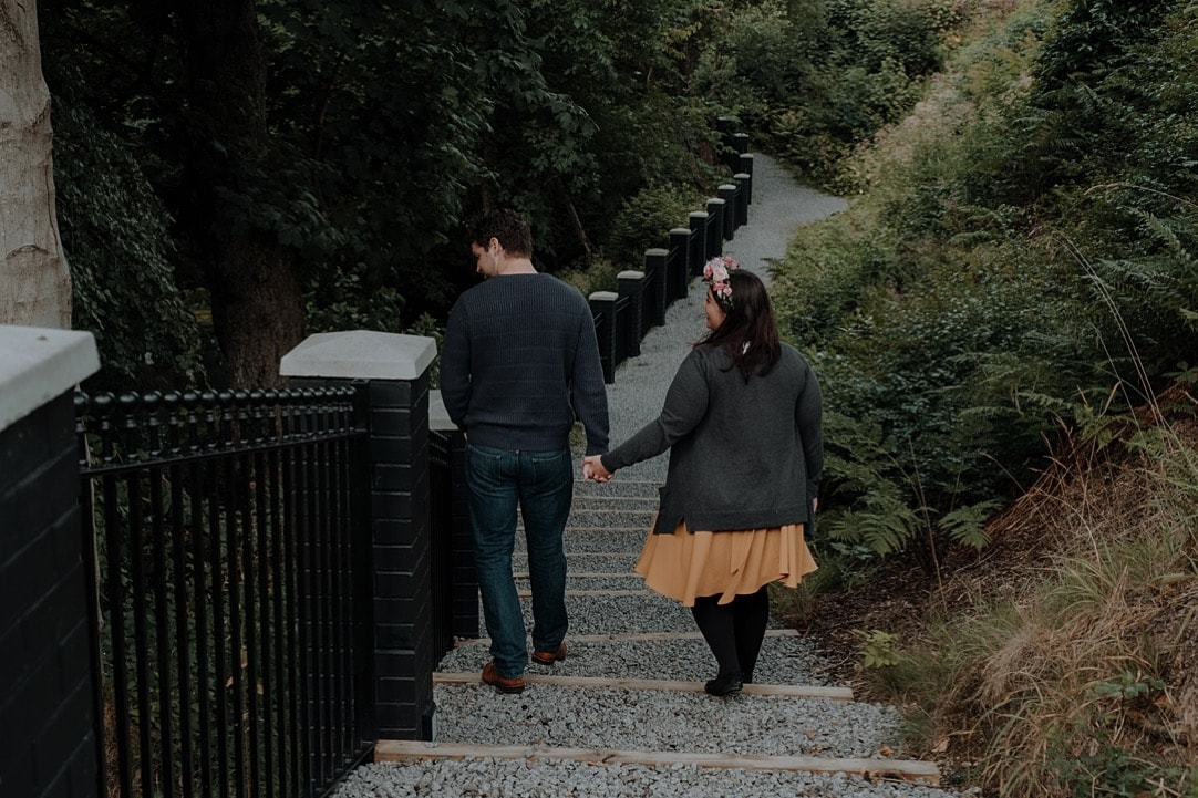 couple holding hands at crossbasket castle