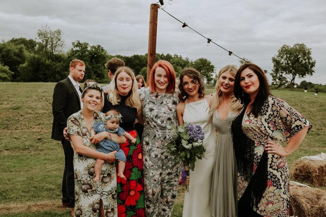 happy-group-shot-bride-with-friends-rustic-diy-farm-wedding