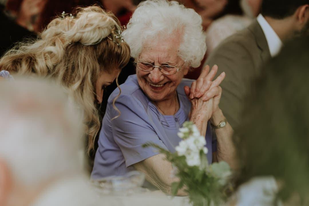 wedding-breakfast-candid-shot-grandma-smiling