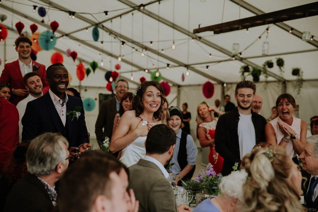 brides-reaction-bridesmaid-recieves-propsal-wedding-breakfast-surprise-proposal