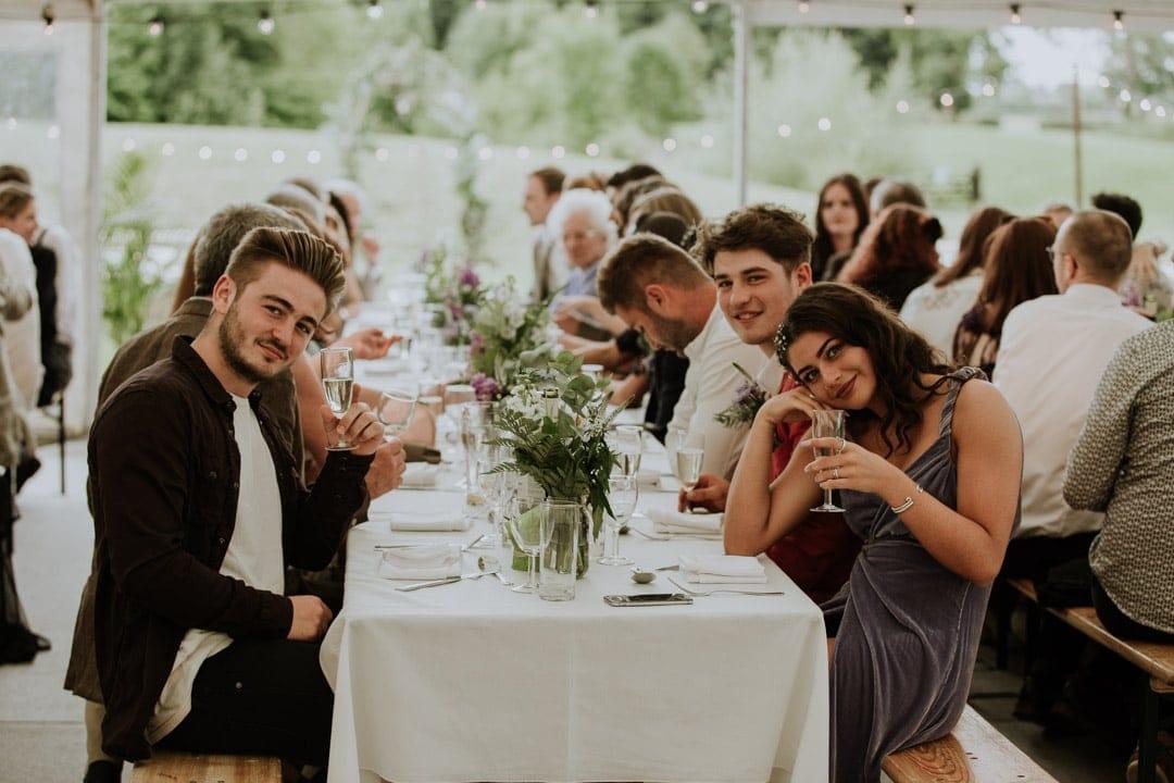 guests-drinking-champagne-diy-farm-wedding
