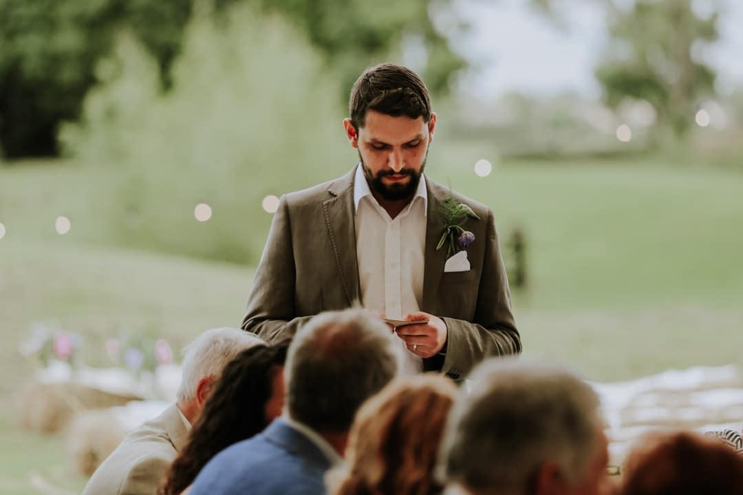 bearded-groom-wearing-green-suit-diy-farm-wedding-christine-mcnally-wedding-photography