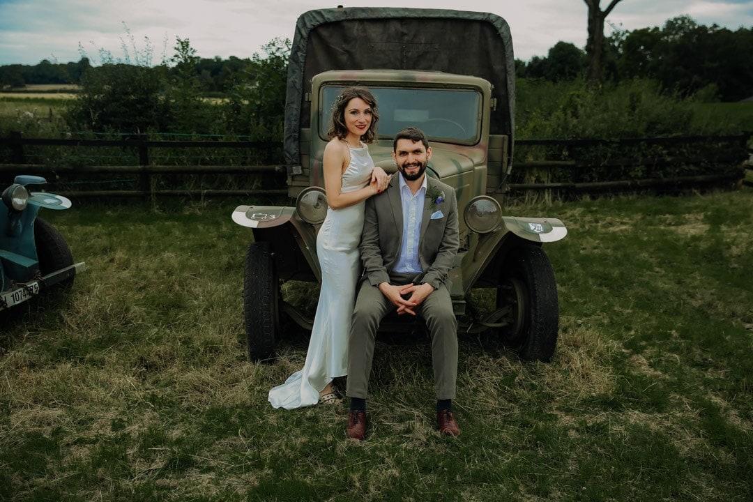 bride-groom-with-vintage-car-farm-wedding-leicestershire