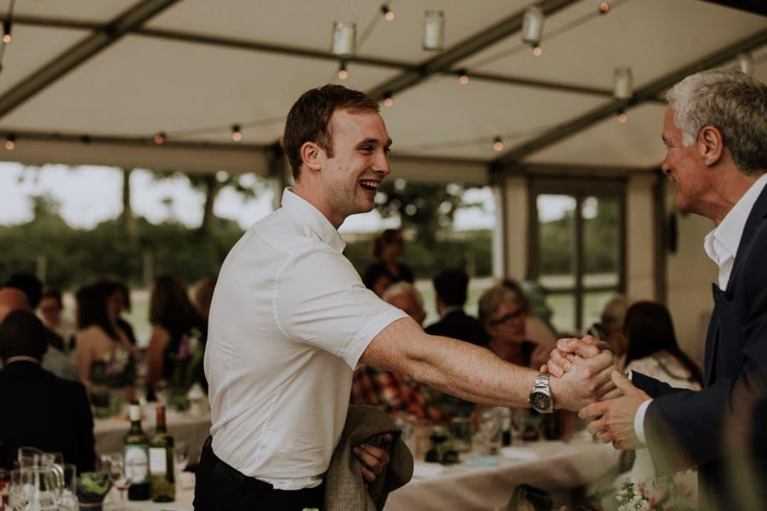 wedding-guests-shake-hands-diy-farm-wedding