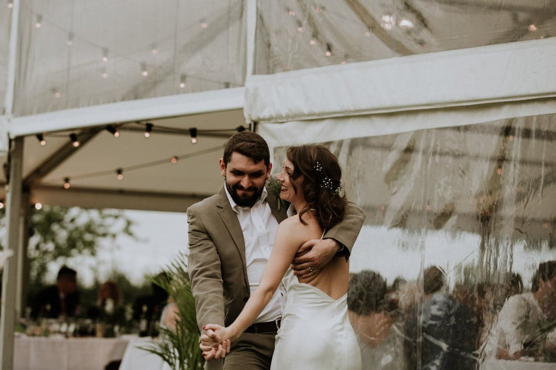 bride-groom-dancing-satin-backless-wedding-dress