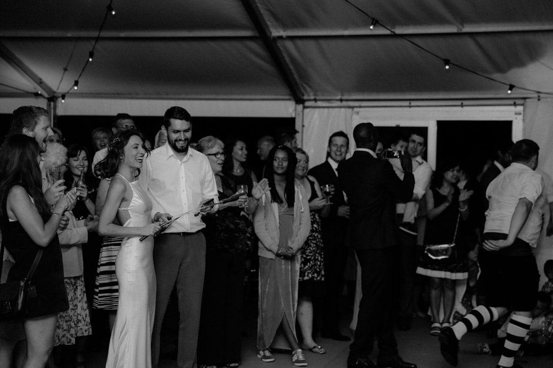 wedding-reception-fun-guests-under-marquee-diy-wedding