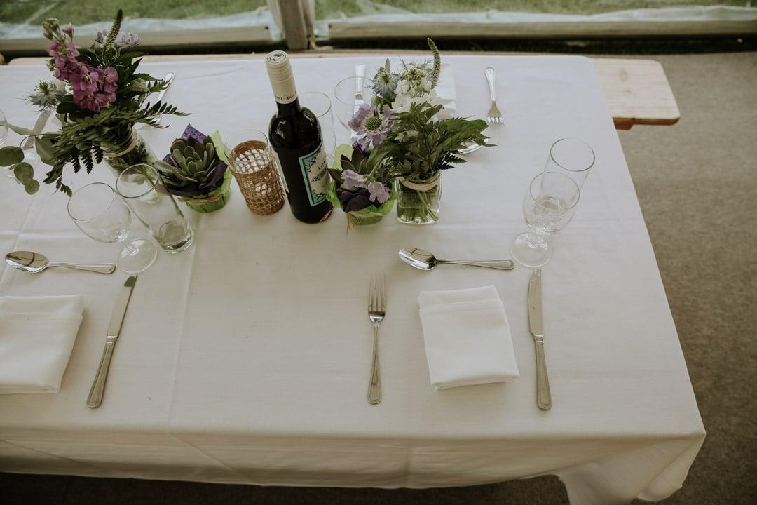 table-wine-flower-decorations-rustic-diy-farm-wedding