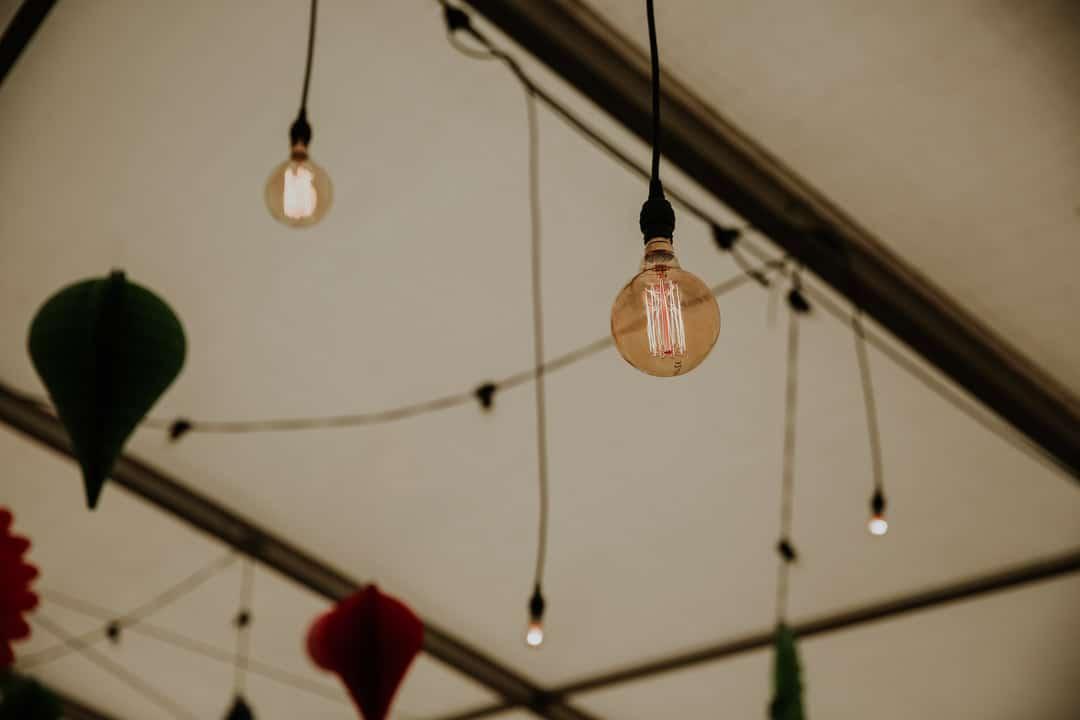 festoon-lighting-inside-marquee-leicestershire-wedding-photographer