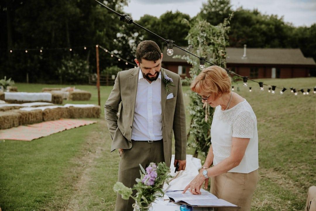 groom-wearing-relaxed-wedding-suit-farm-wedding
