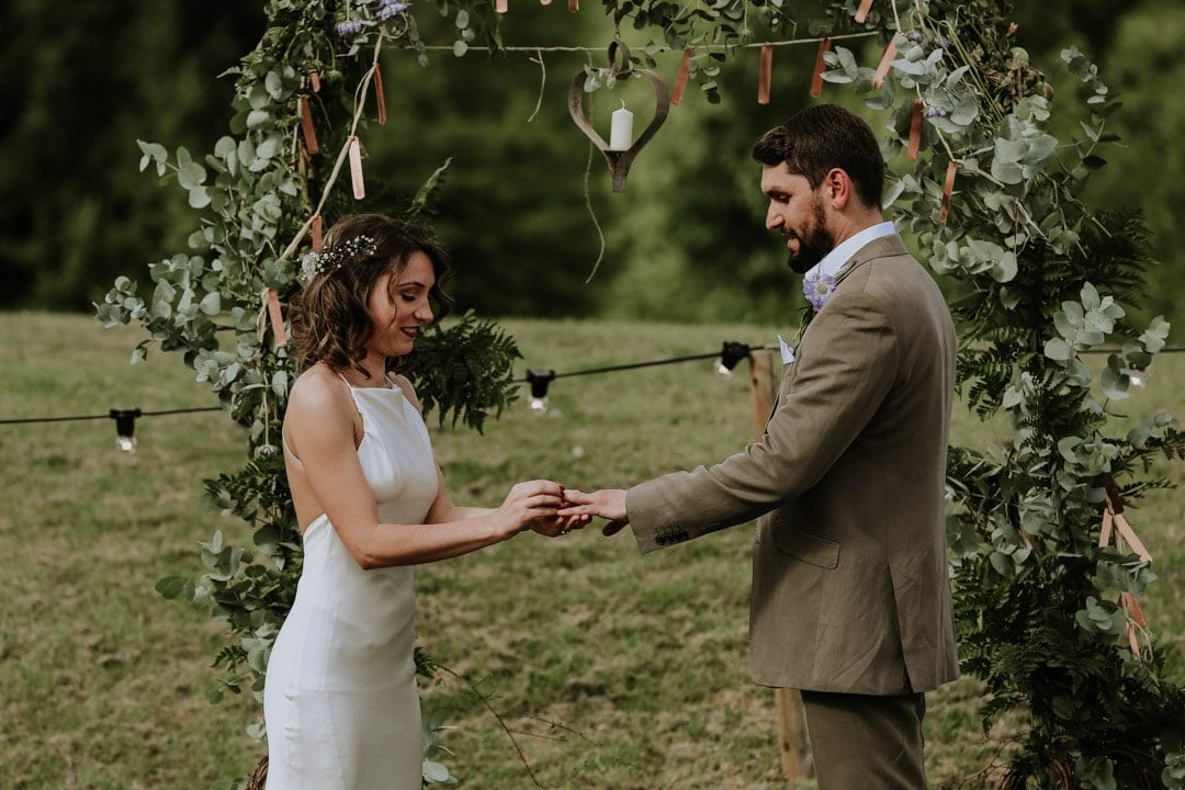 bride-exchanges-rings-with-groom-artistic-wedding-photography
