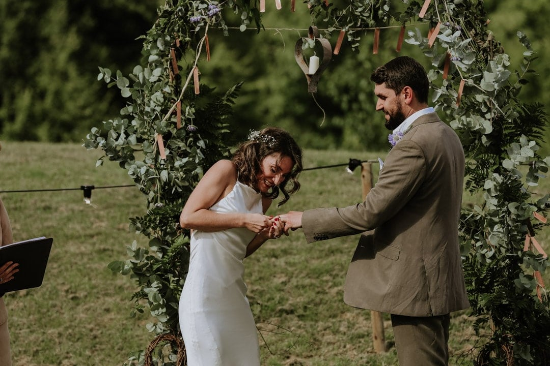 bride-struggling-putting-ring-on-grooms-finger-leicestershire-wedding