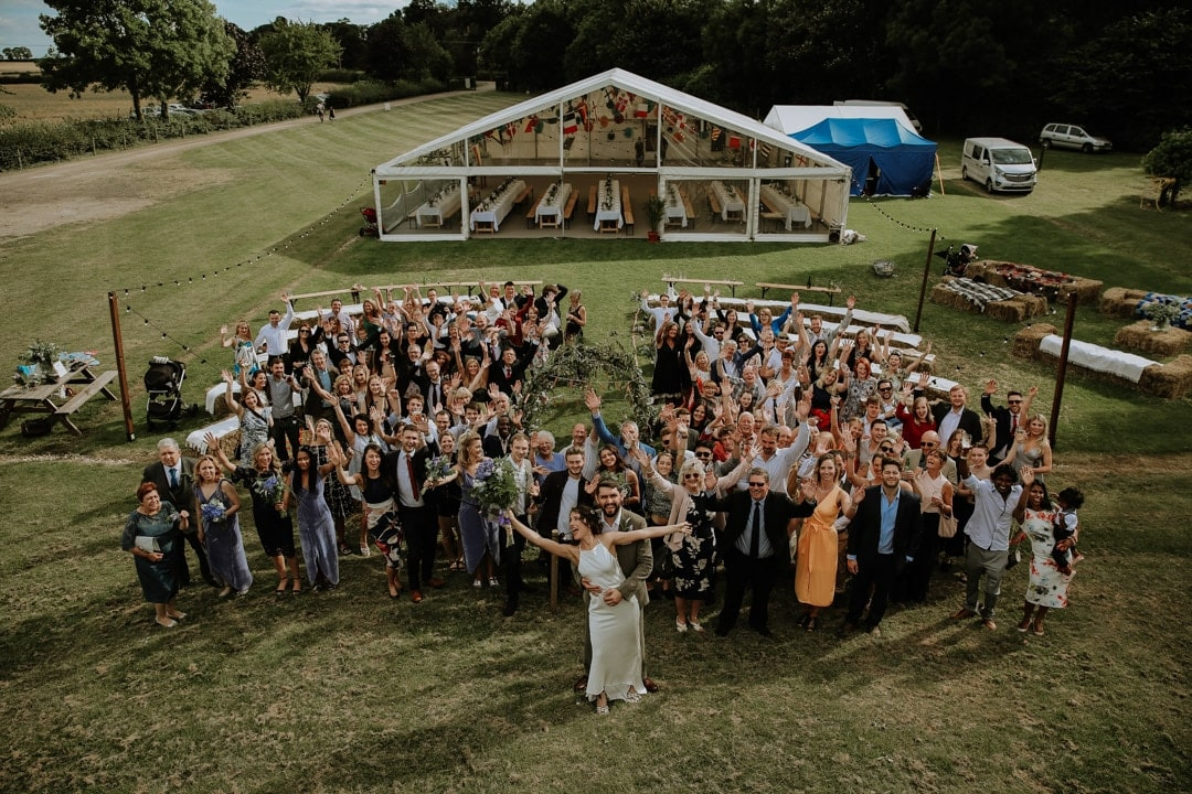 fun-arial-group-shot-leicester-farm-wedding-christine-mcnally-photography