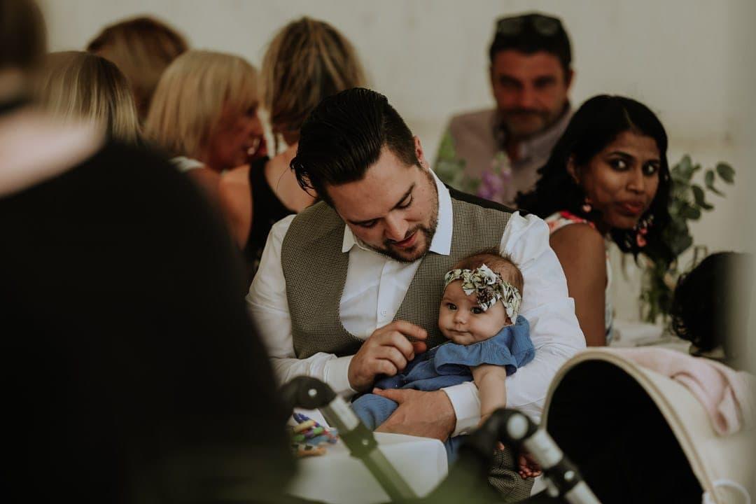 baby-wearing-floral-headband-wedding-breakfast-leicestershire-wedding-photogrpaher